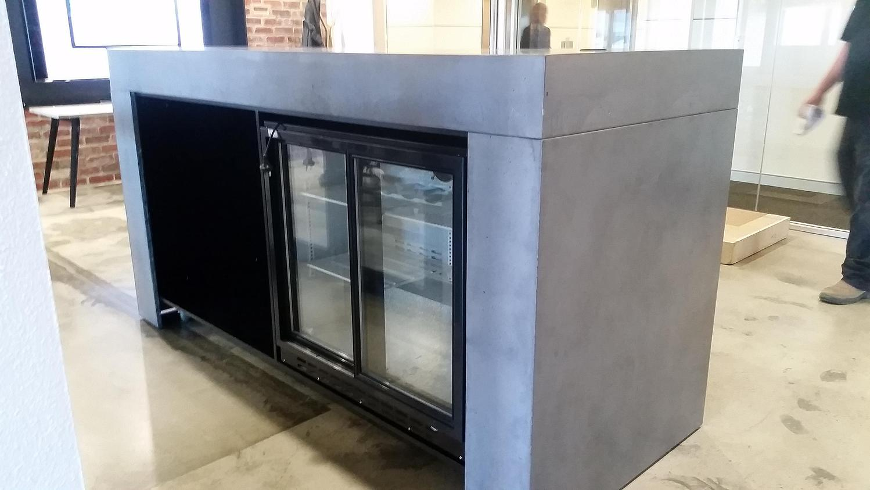 concrete reception benchtop with fridge