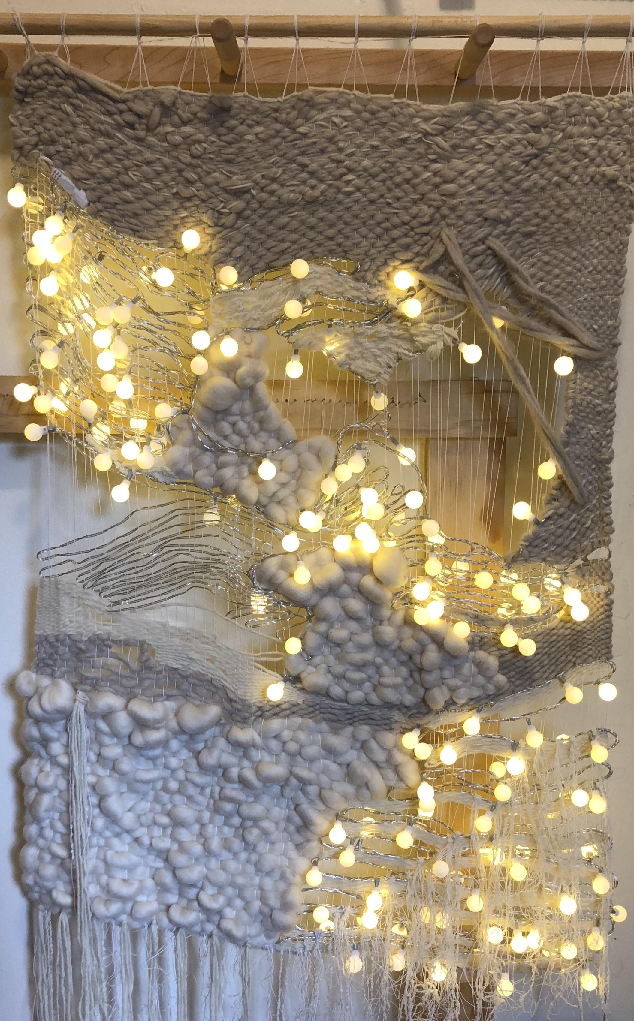 Our warmth, it beckons something more   (2018)  wool, LED lights, cotton, silk, roving  46 x 25 x 2in