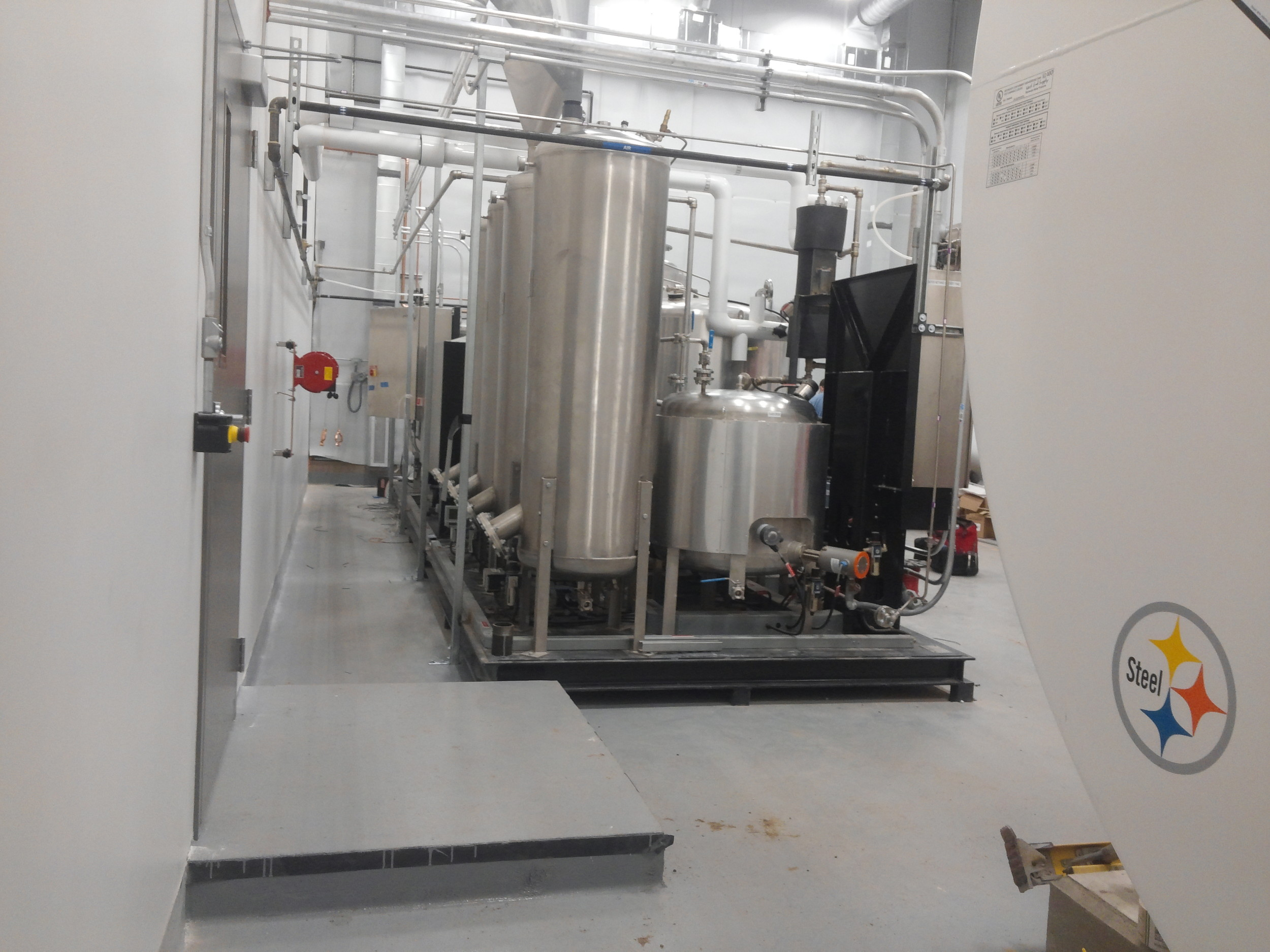 NB processor and methylate tank in new processing room.jpg