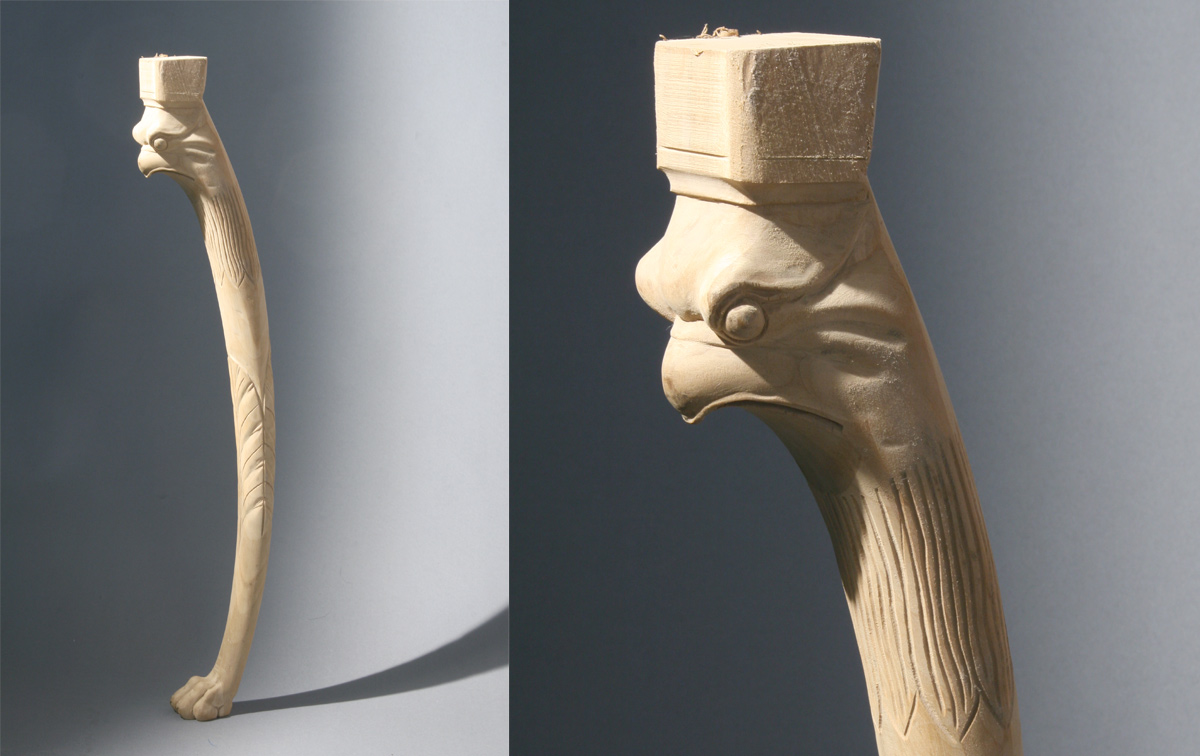 Hand carved table leg