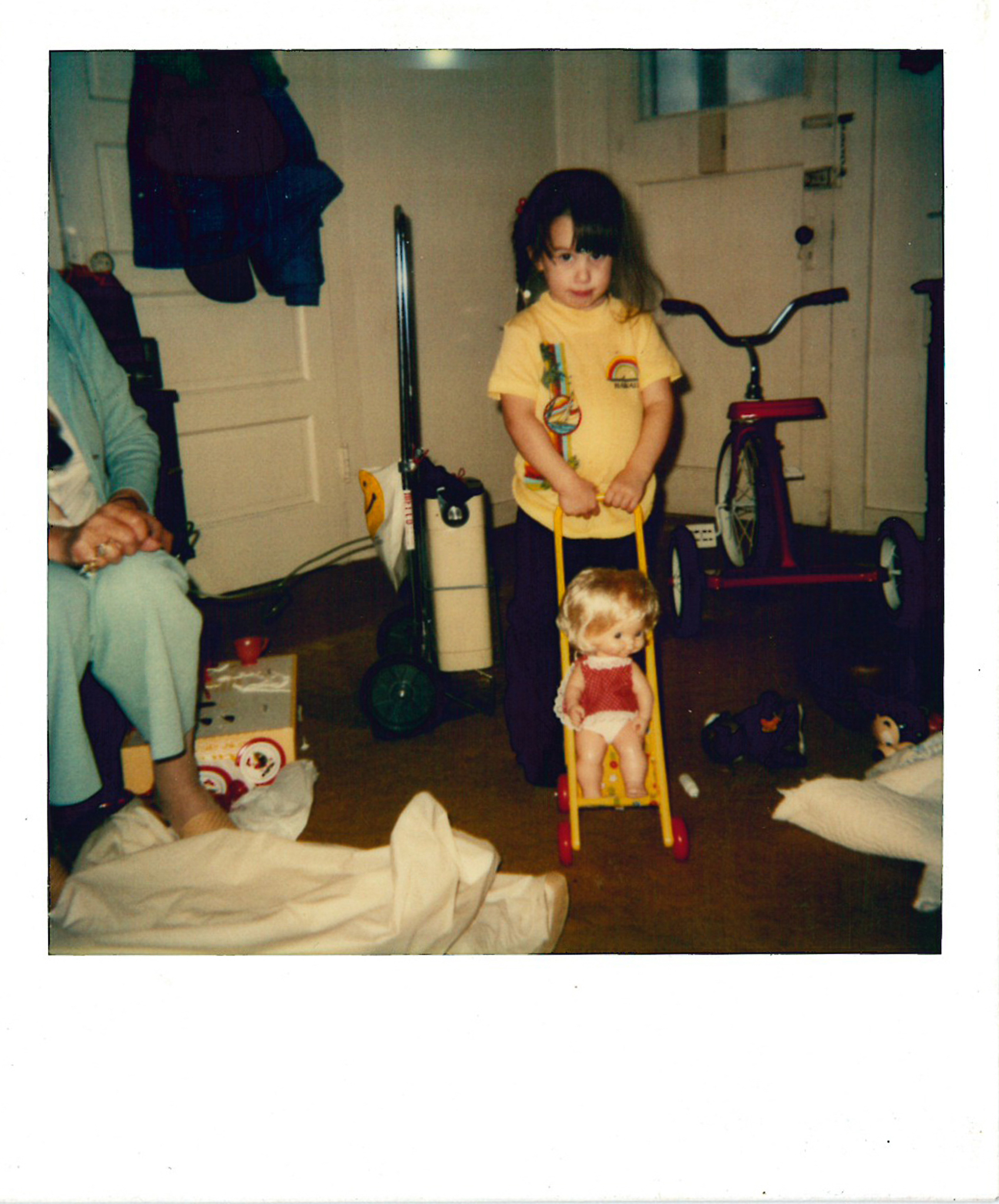 My favorite dolly and stroller. This was taken in a home we moved out of when I was around 6 years old. I love looking back at remembering that old house.