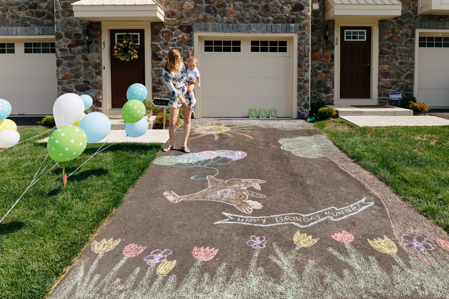1st birthday party chalk decorations in driveway