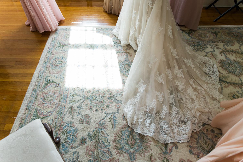 Brides dress in window light
