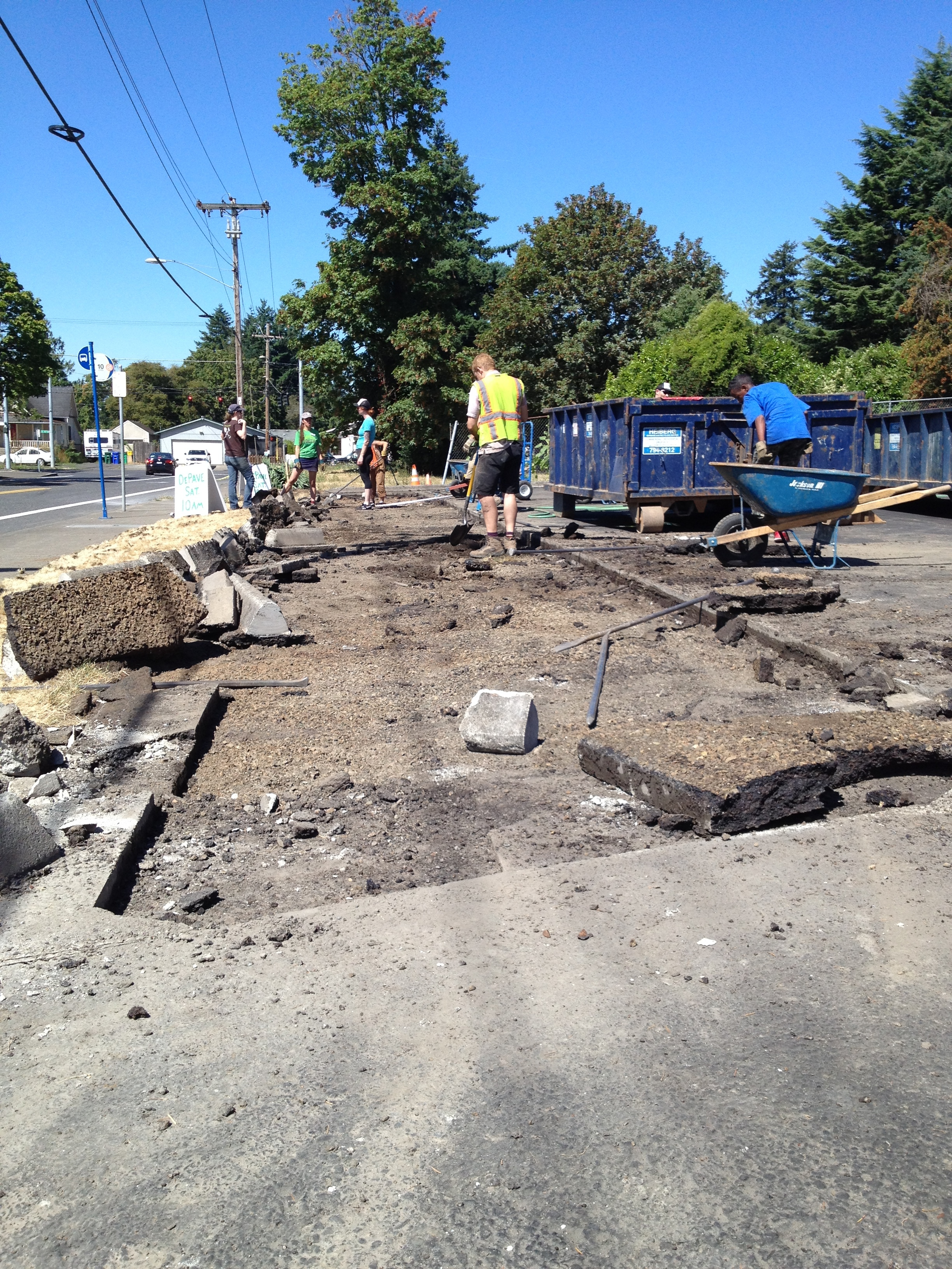 Green Lents & ROSE CDC partner with DePave to remove concrete, revealing compacted and degraded urban soil.