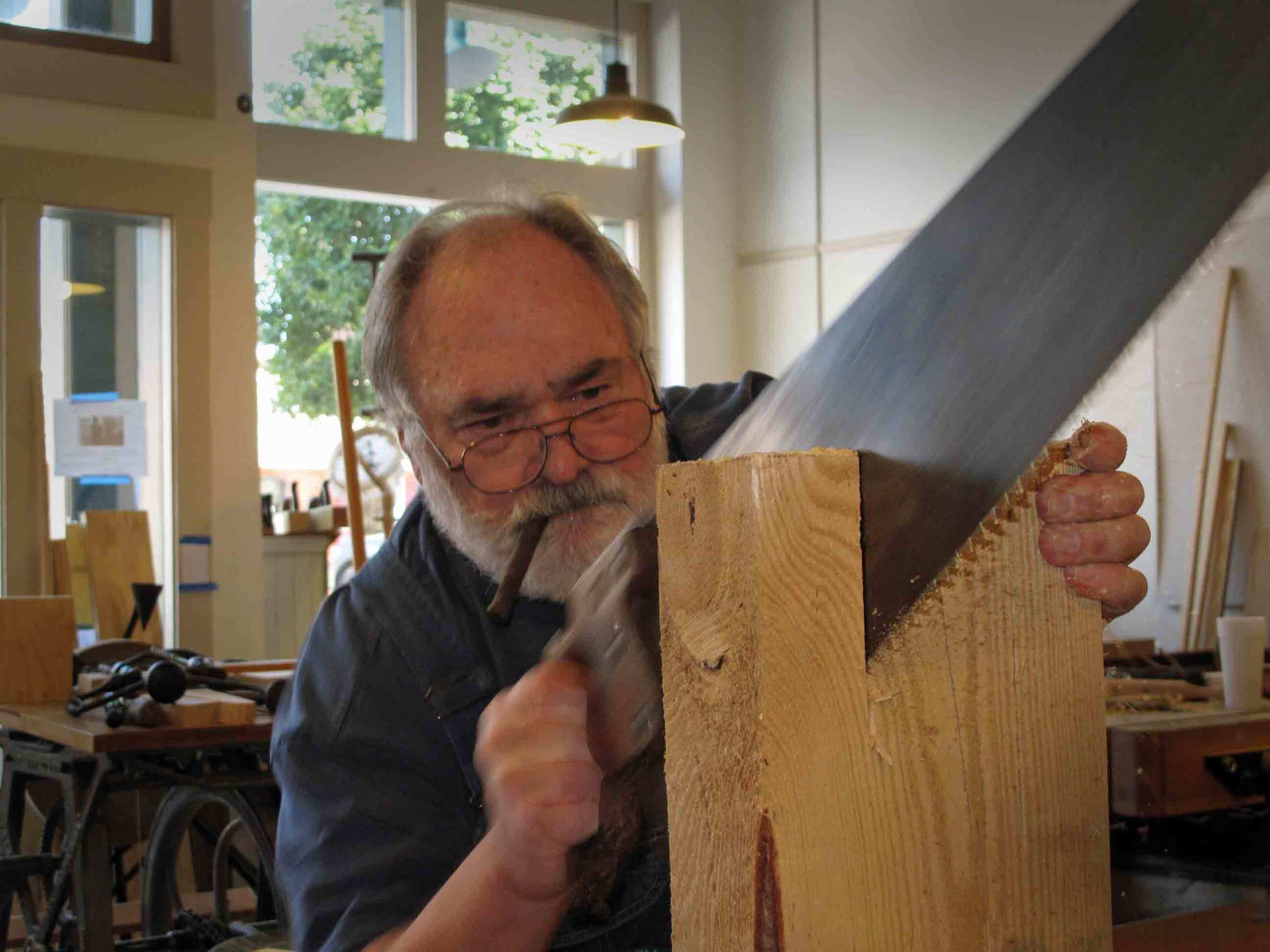 Student-saws-with-cigar.jpg
