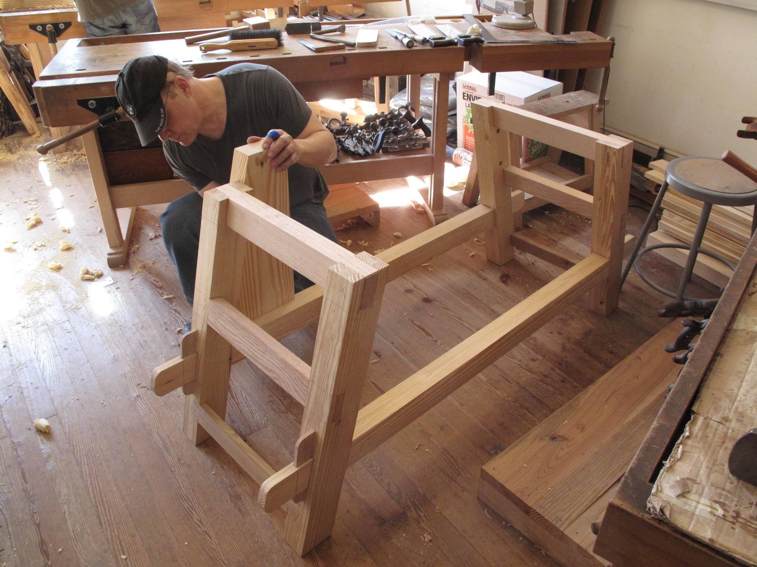 Student makes bench frame.jpg