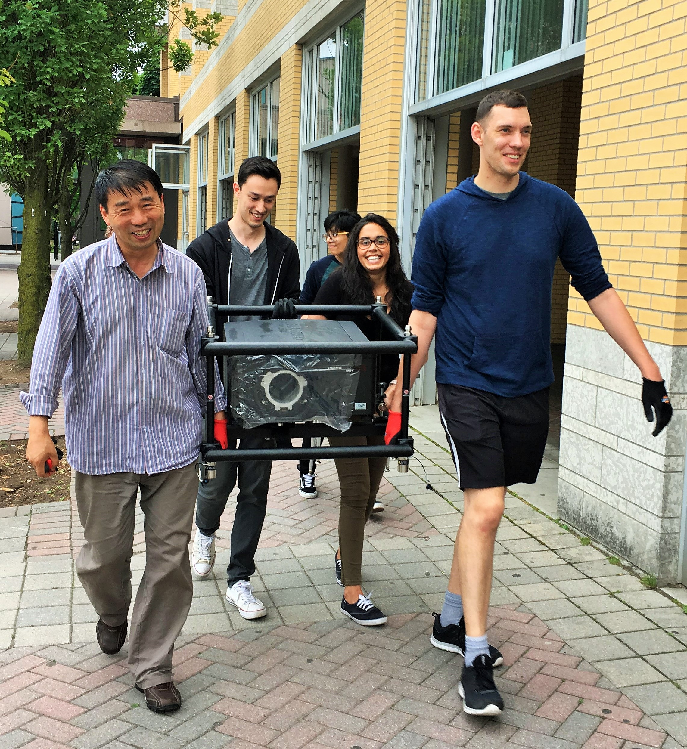 Transporting the Christie Mirage 3D projector with utmost care.