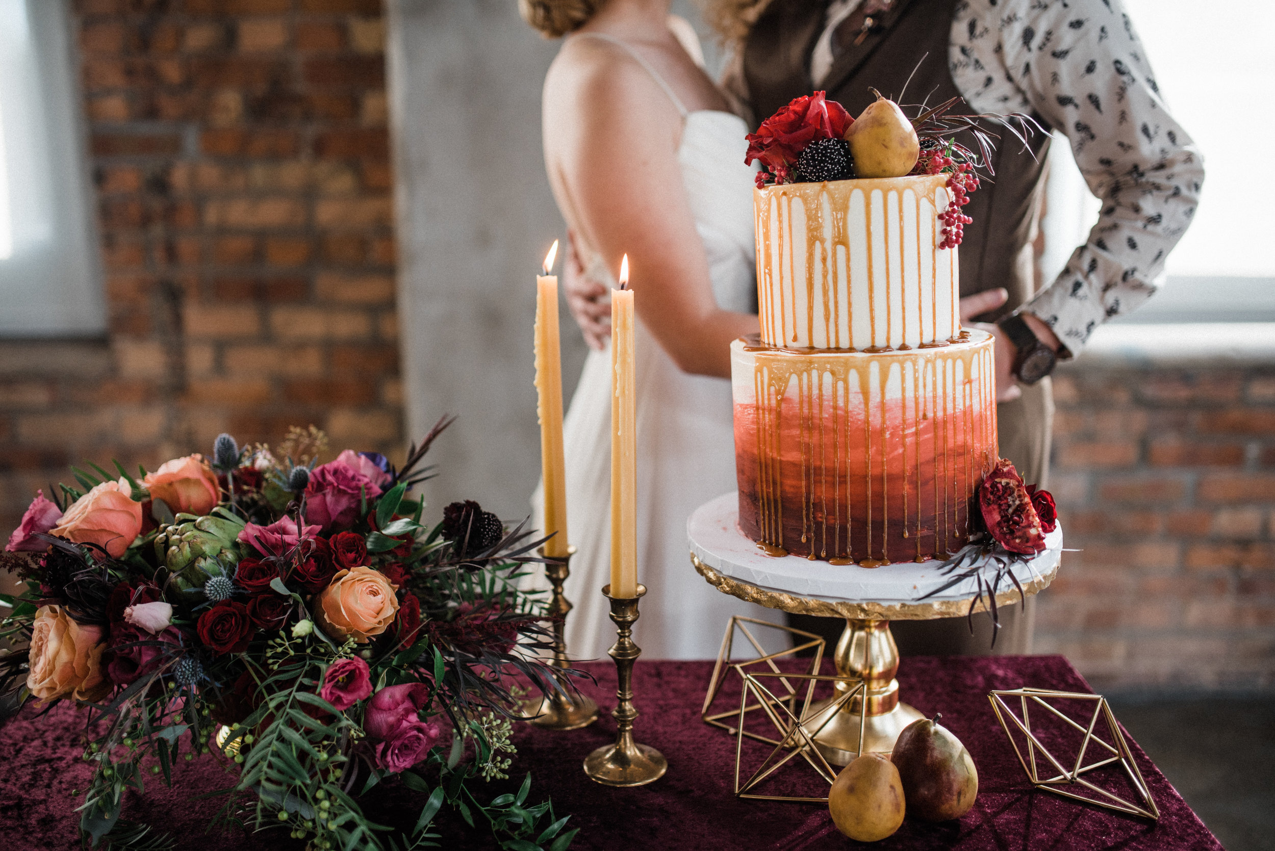 Flower arrangements by The Flower Man, decor from Something Old Dayton, planned and styled by Perry Rose Media, and photographed by Chelsea Hall. Wedding dress from Celia Grace. Shot at Steam Plant in Dayton.
