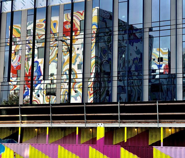"""""""I'm glad someone built this across the street so I can admire myself.."""" - @fairhaireddumbbell #reflection #glass #mural #jamesjean"""