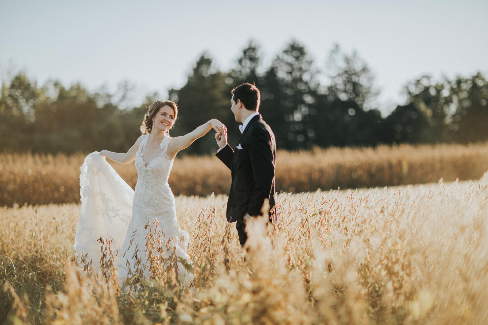 Bride and Groom in Farm Field.