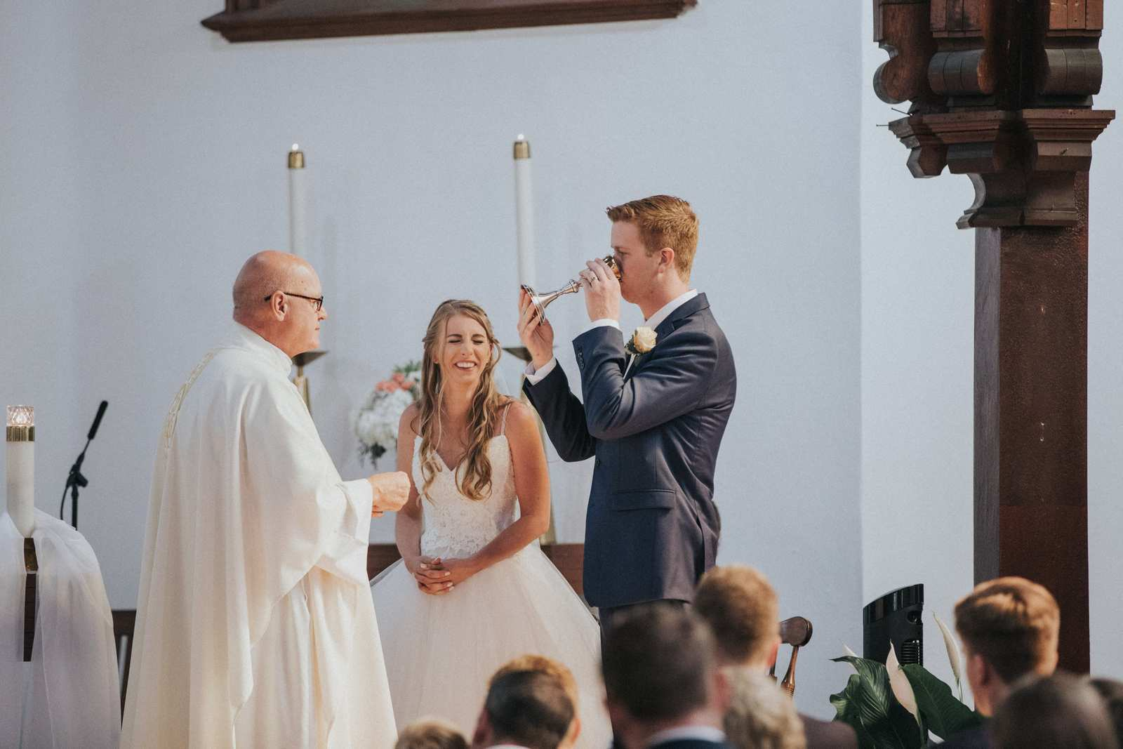 A rather humorous moment during a wedding ceremony as the groom drank the communion wine at a church in Middletown NJ. On this same wedding day we traveled to Deepcut Gardens and then the Oysterpoint hotel!