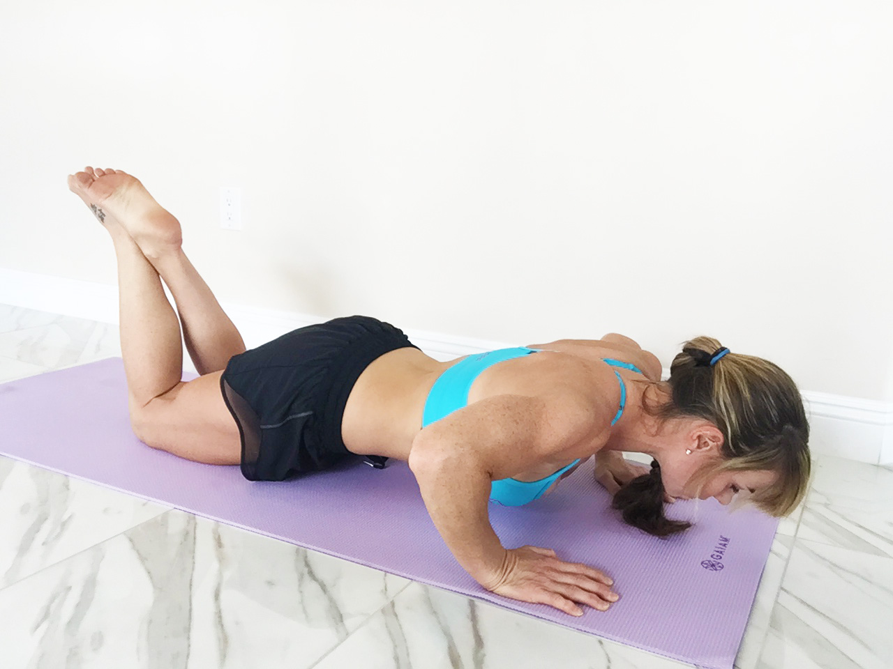 Push ups on your knees is a good place to start without straining your back.