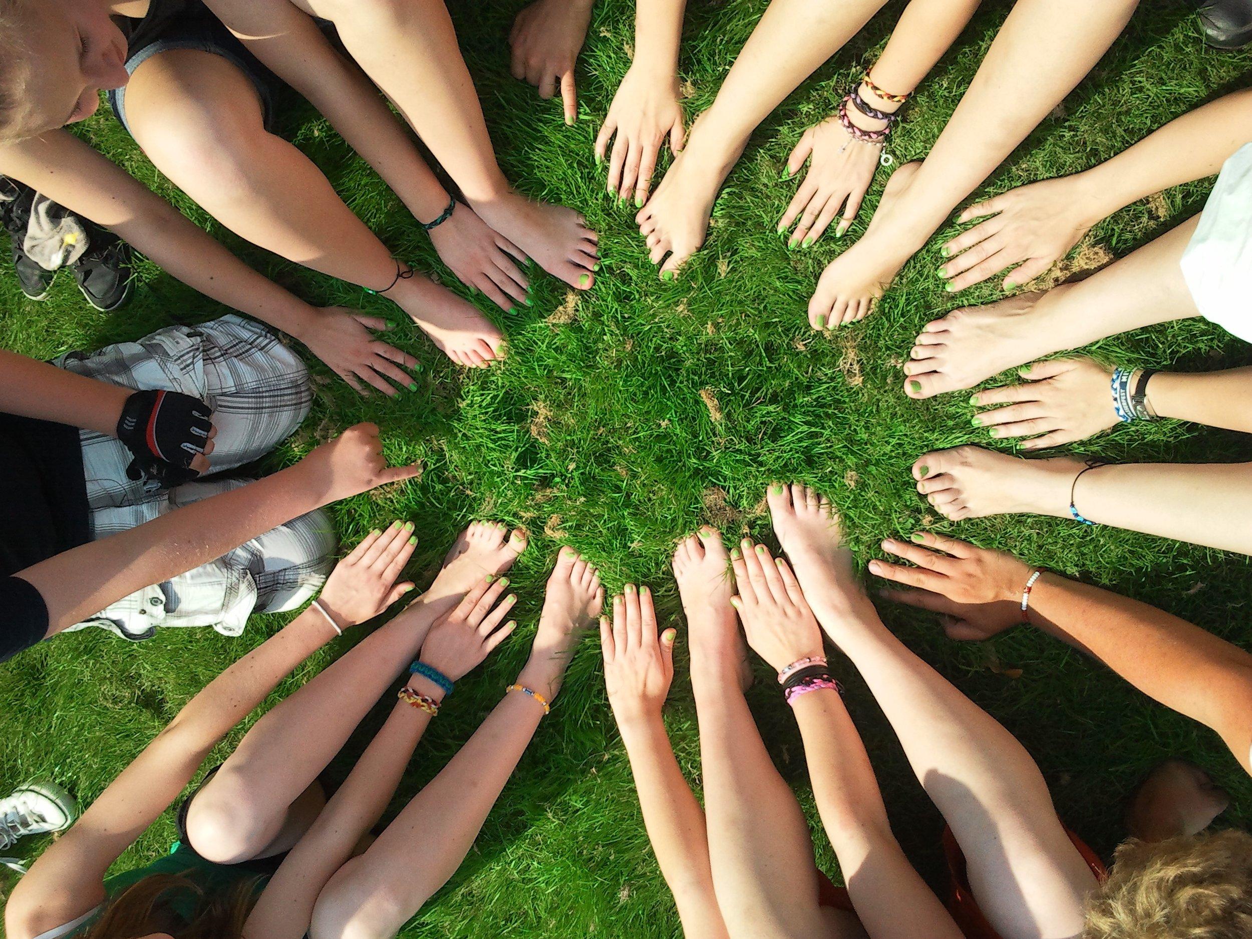 pexel woman circle feet hands on grass.jpg