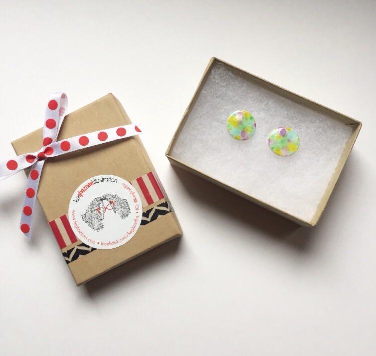 Earrings displayed in Kraft jewelry box.