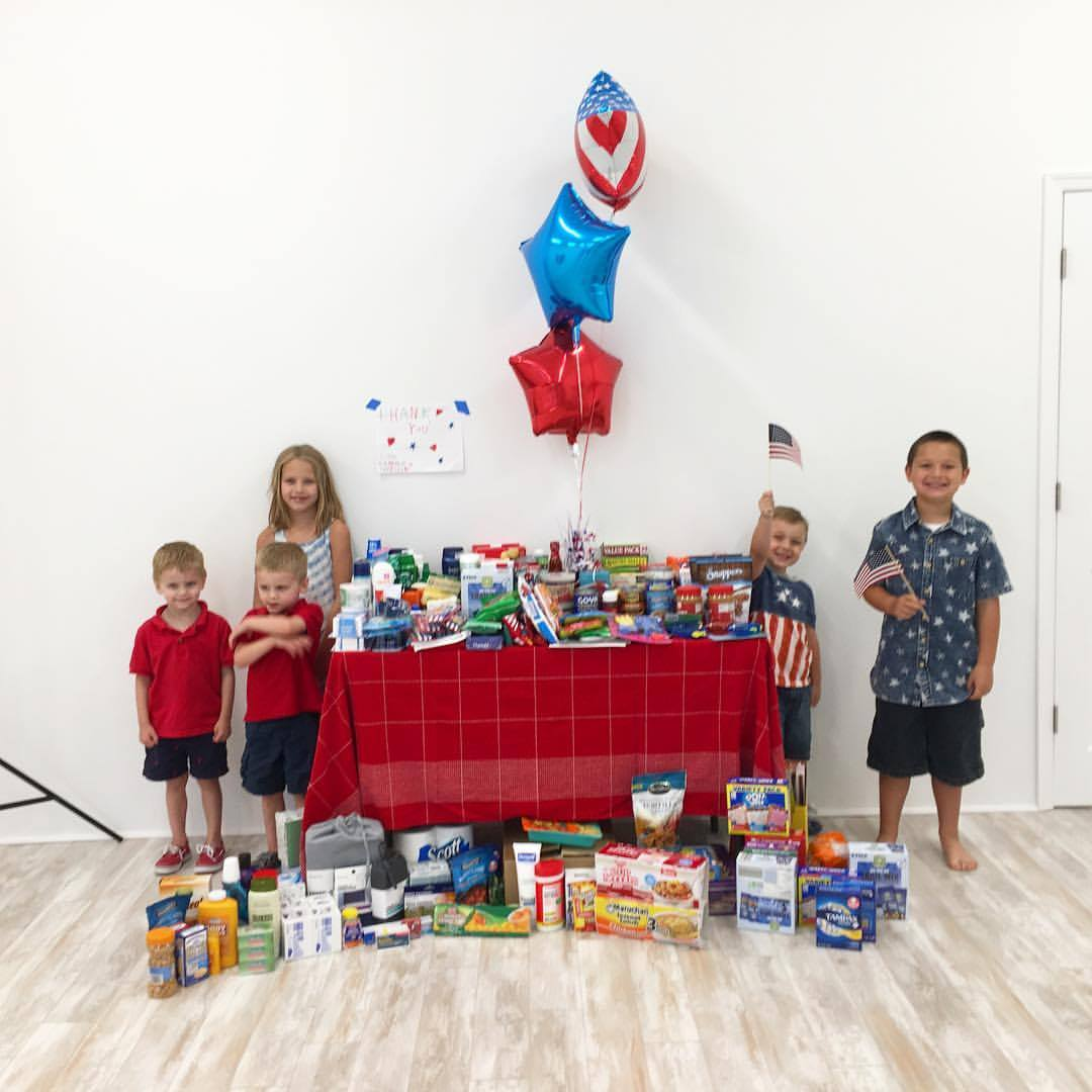 kids with donations.jpg