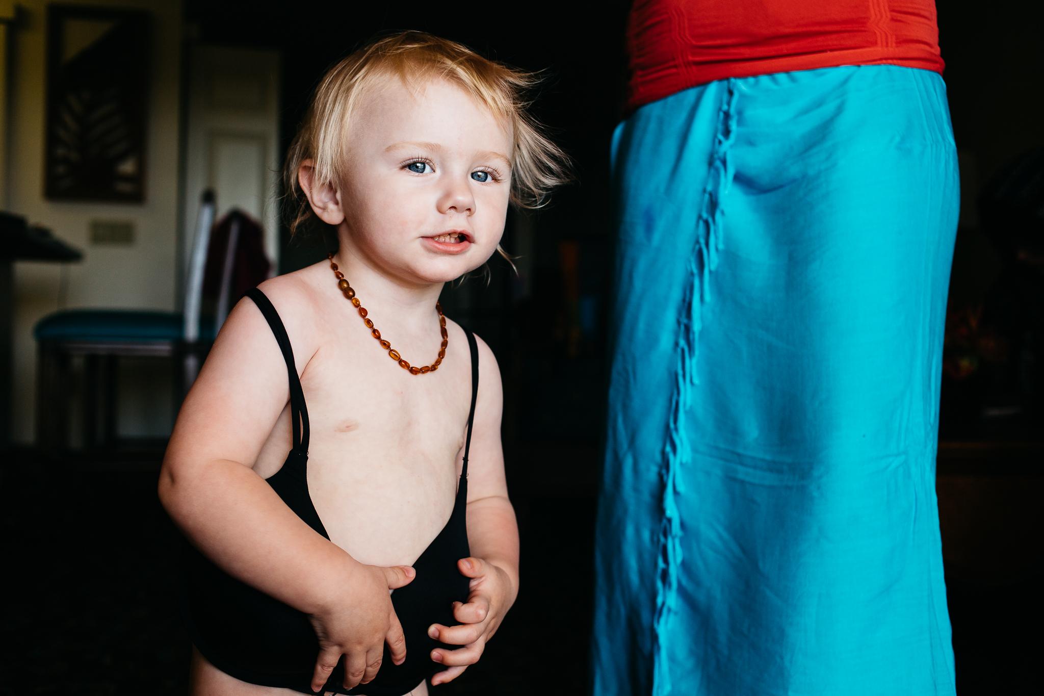 Toddler girl wearing mom's nursing bra.