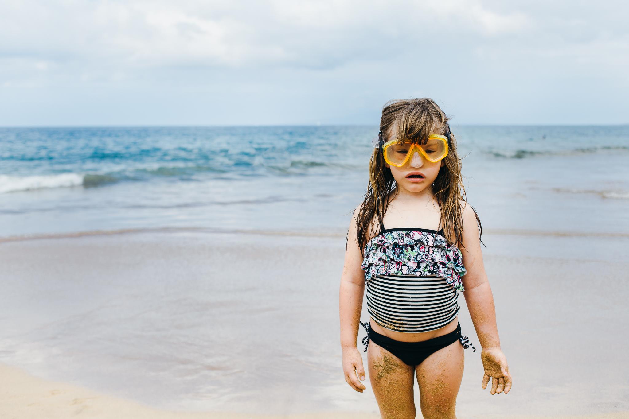 Scuba girl on beach.