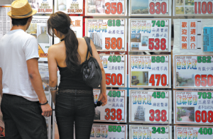 Chinese parents will help a male relative buy a home before a daughter. Searching real estate listings in Hong Kong. (ALEX HOFFORD FOR THE INTERNATIONAL HERALD TRIBUNE)