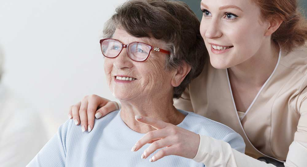 An older adult patient and a nurse.