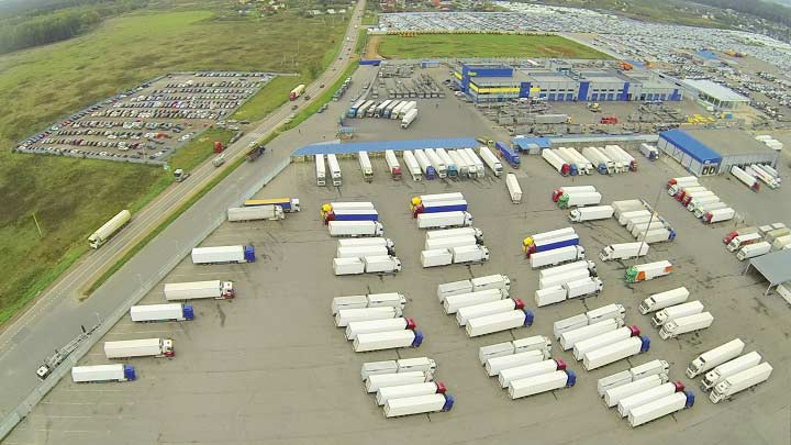 A parking yard full of trucks and trailers.