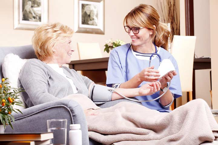 Patient and nurse in healthcare setting.