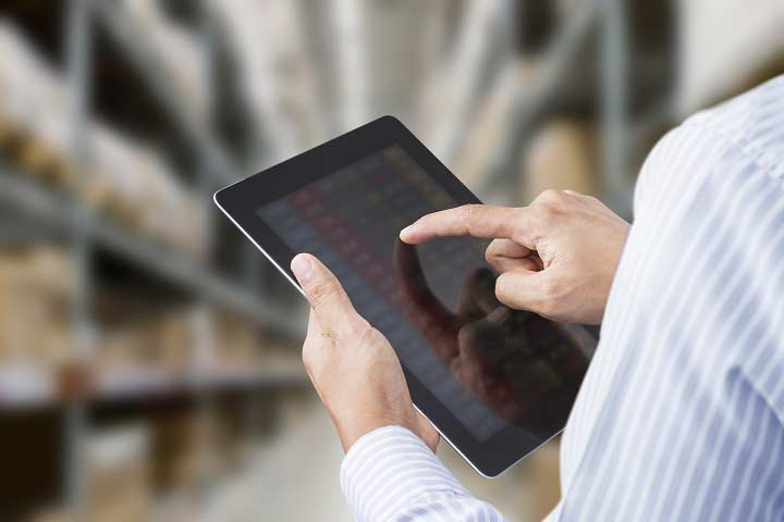 Using a tablet to show asset locations in a warehouse.