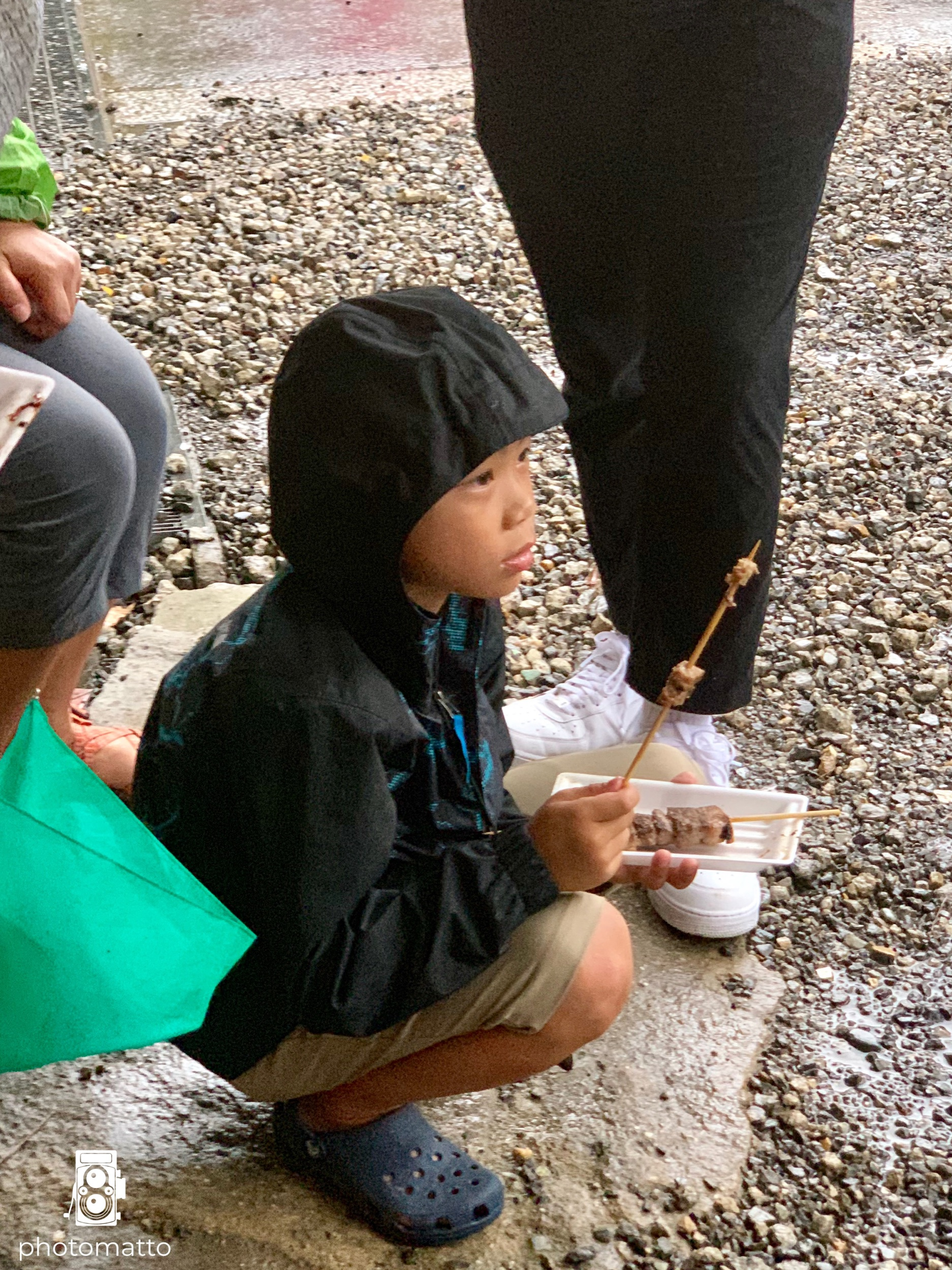 Thien was enjoying his meat stick and the fact that we found someplace undercover and dry to eat.