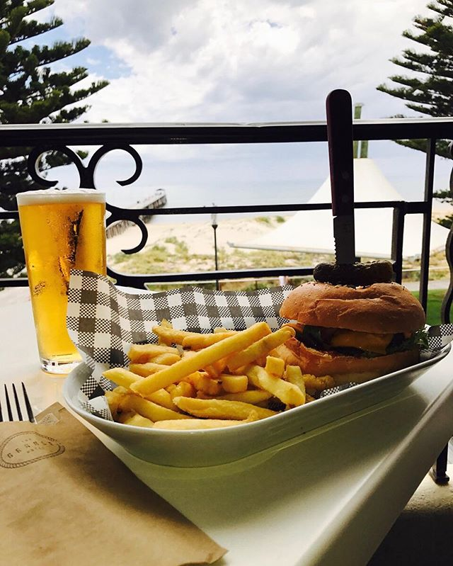 Indulge yourself in our home-made cheeseburger by the seaside // for just $15! #grange #grangehotel #beach #seaside #Adelaide #esplanade #mealdeal #meal #food #lunch #dinner #delicious #burger #chips #pint #winning #summer #instafood #foodporn
