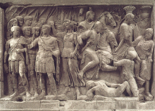 Fig. 5 Arch of Constantine, Rome. Trajanic panel from central passageway of arch with inscription FUNDATORI QUIETIS.