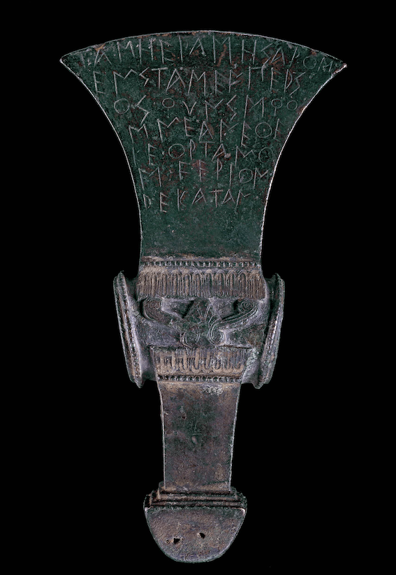 Figure 3.2 Bronze ceremonial shaft-hole axe head, inscribed with a dedication to Hera. Ca. 520 BCE. From San Sosti, Calabria. 16.5 cm × 8.8 cm. London, British Museum 1884,0614.31.