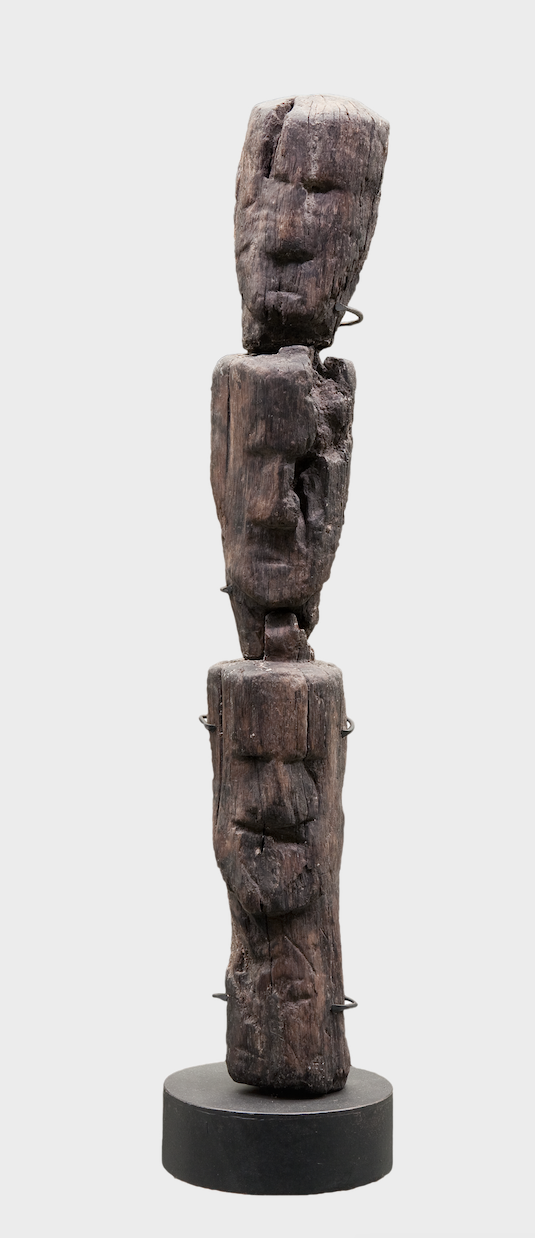 Figure 3.4 Stacked wooden heads from the sanctuary at the source of the Seine. Ca. early first century CE. 70 × 10 × 8 cm. Dijon Archaeological Museum 75.2.80.  Photo by François Perrodin, used with the kind permission of Dijon Archaeological Museum.