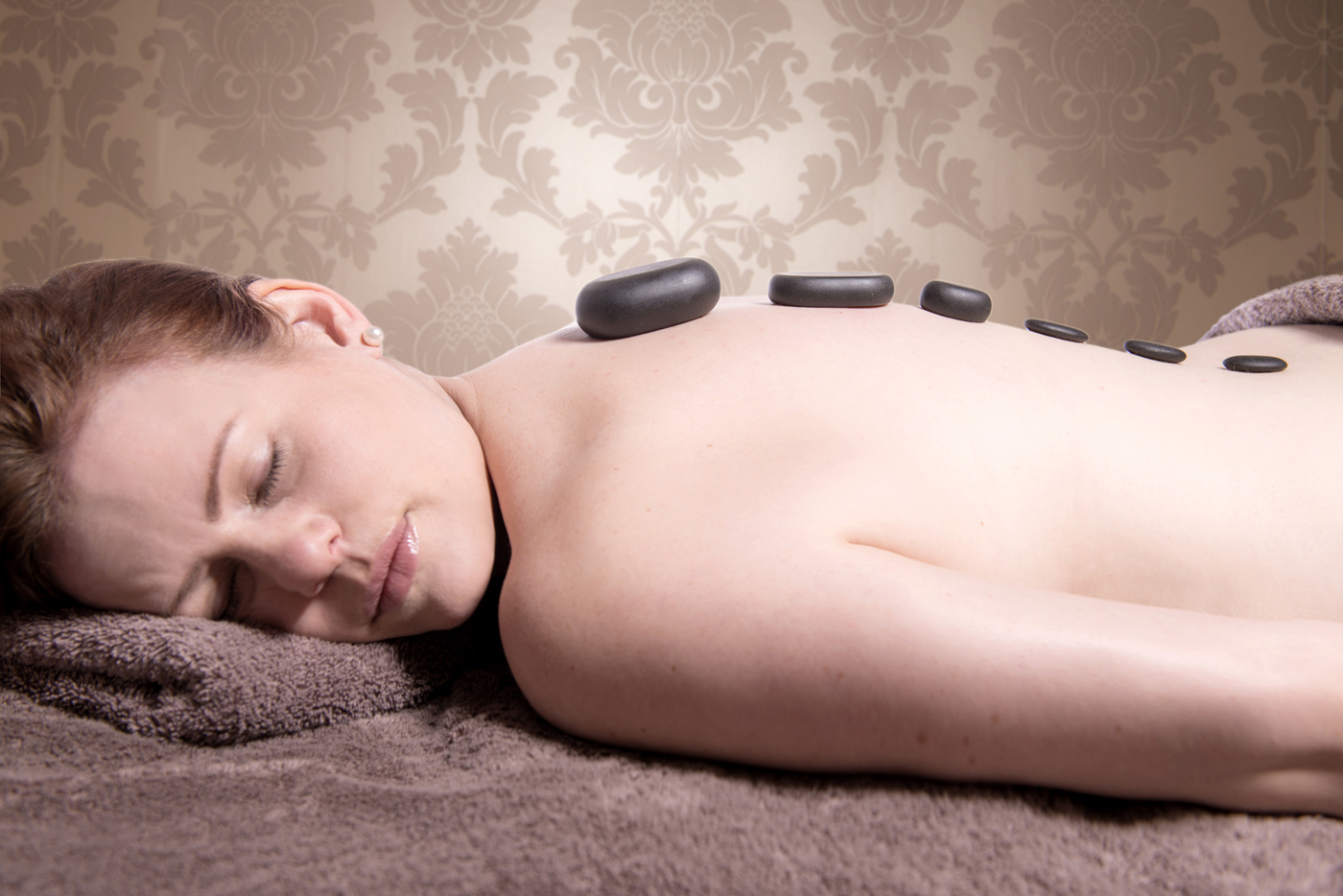 Hot Stone Massage - A deep healing and relaxing massage using heated stones applied directly to the skin to melt away tension and ease aching muscles