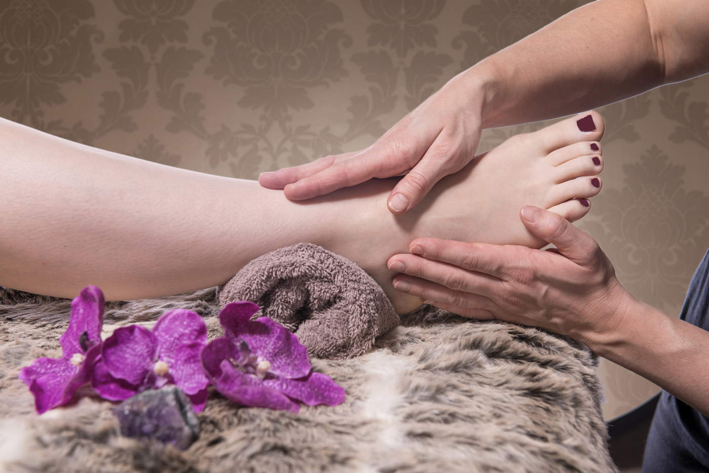 Reflexology - A natural therapy performed on the feet using massage with varying degrees of pressure to stimulate the movement of energy in the reflex zones