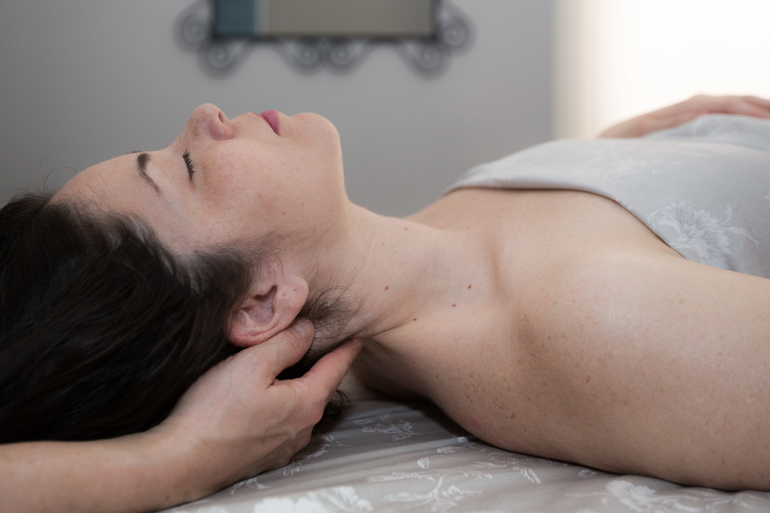 """Biodynamic Craniosacral Therapy - Biodynamic Craniosacral Therapy is a gentle form of bodywork that helps to release tension held deep within the nervous system so that the rest of the body can relax and start to heal from the inside out. This hands-on therapy is non-invasive and non-manipulative, practiced as taught by Franklyn Sills, and focuses on the """"inherent ordering principal,"""" meaning that each person is born with a """"blueprint of perfect health"""" that remains with us our entire lives, and around which our cellular and tissue world organizes. Resistances and congestion, caused by experiences such as traumas and injuries and influenced by genetics, cause the tissue and fluid relationships of the body to lead to pain and dysfunction.The practitioner listens for and assists the client's inherent healing intelligence to reconnect with its state of balanced health already available.Benefits of Craniosacral Therapy →"""