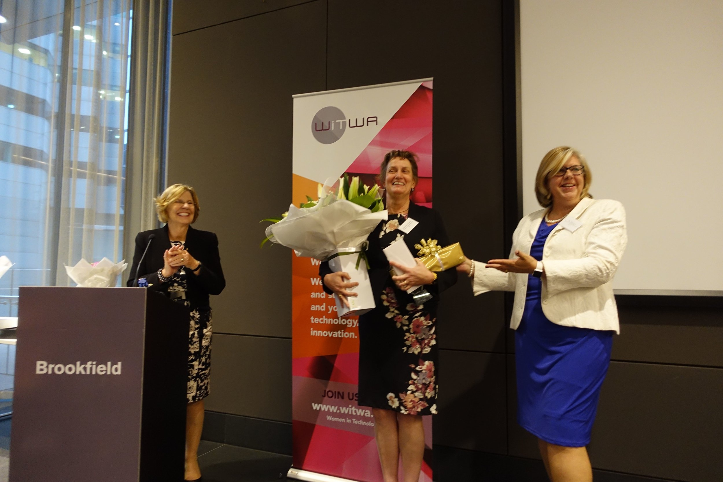 Marjolein Towler being presented gifts OF APPRECIATION by Pia Turcinov