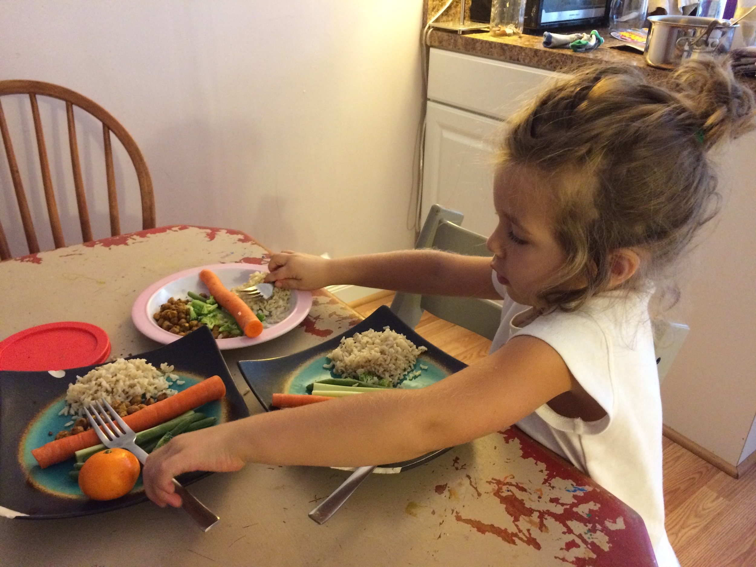 Judah preparing lunch for the family all by herself one day.