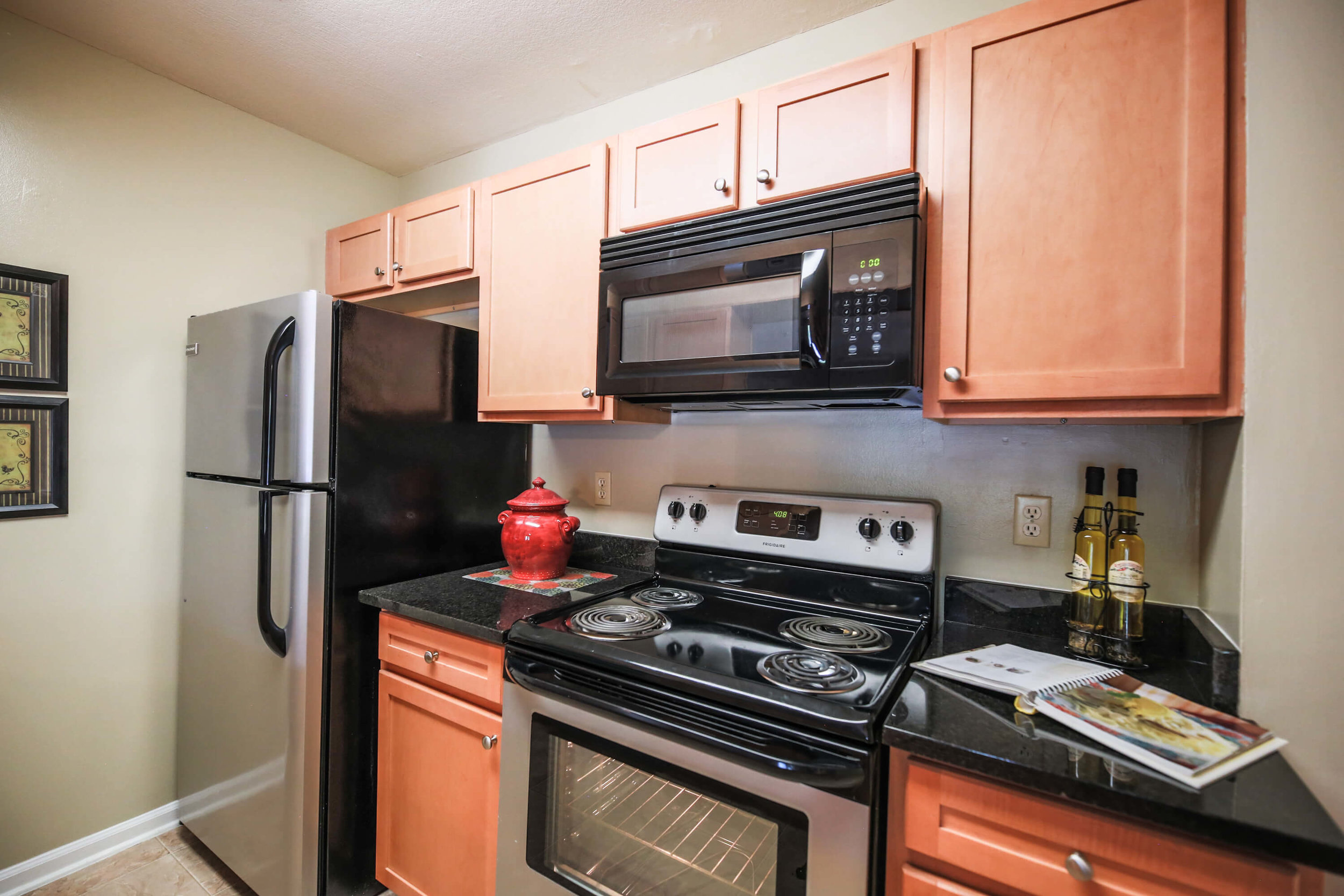 Apartments feature beautiful black granite countertops and new silver and black appliances.