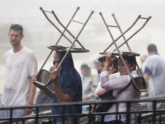 Rain-drenched fans at Preakness 2015. Source: Courier-Journal