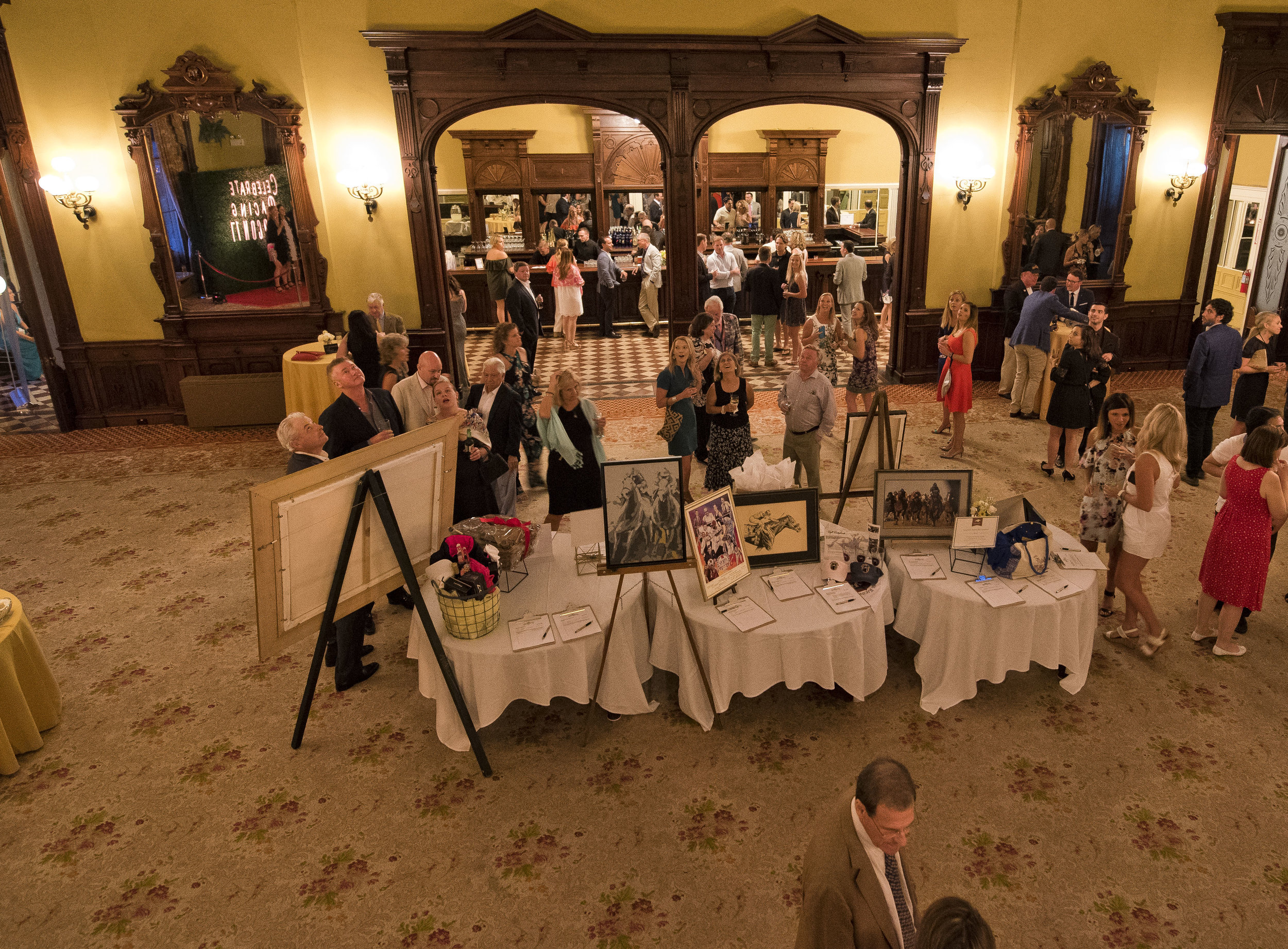 Guests peruse the silent auction benefitting the TAA and Man O'War Project at the Equestricon 2017 VIP Party (Eclipse Sportswire)