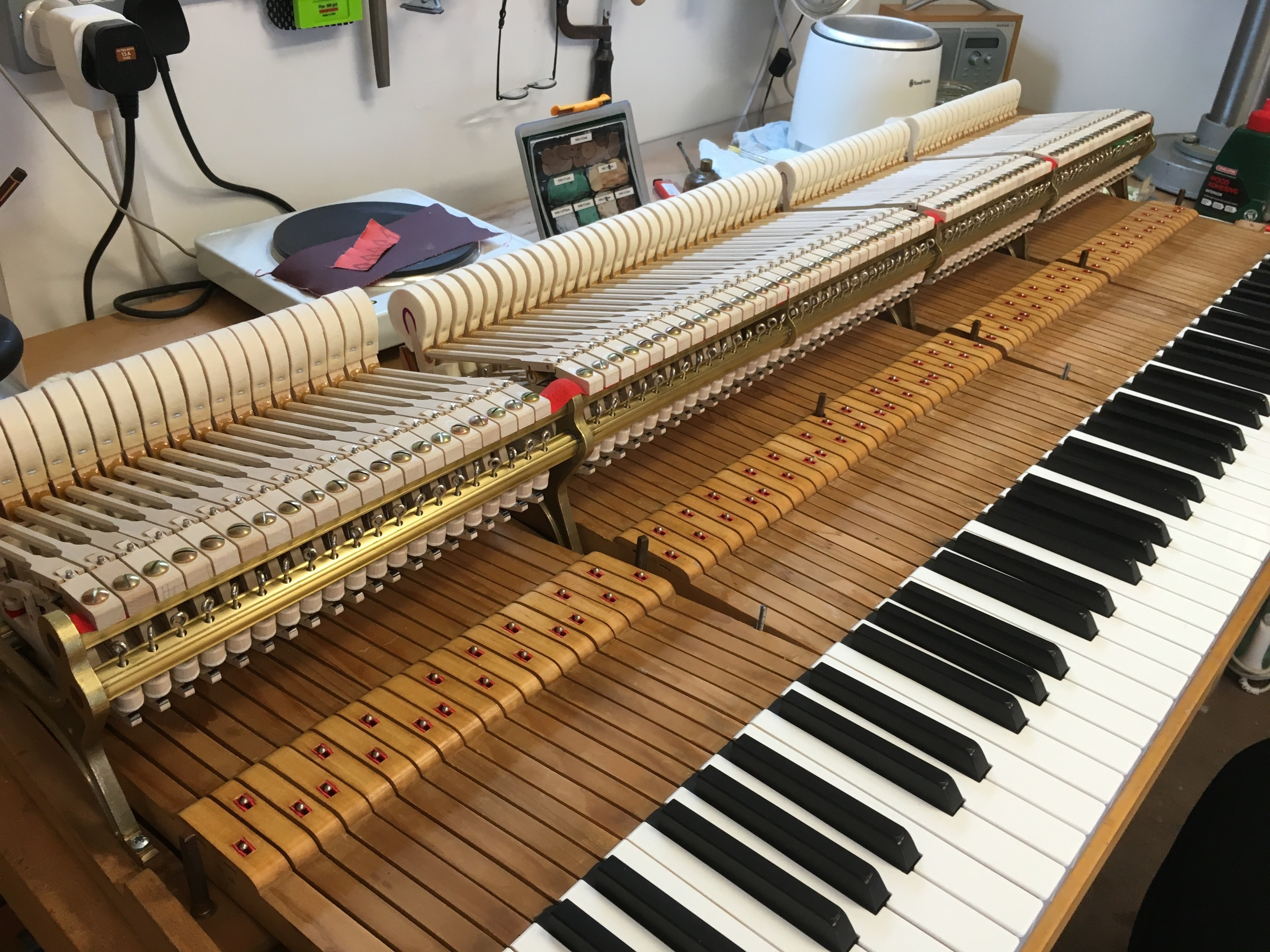 New action fitted to re-covered keys - prior to key wood cleaning