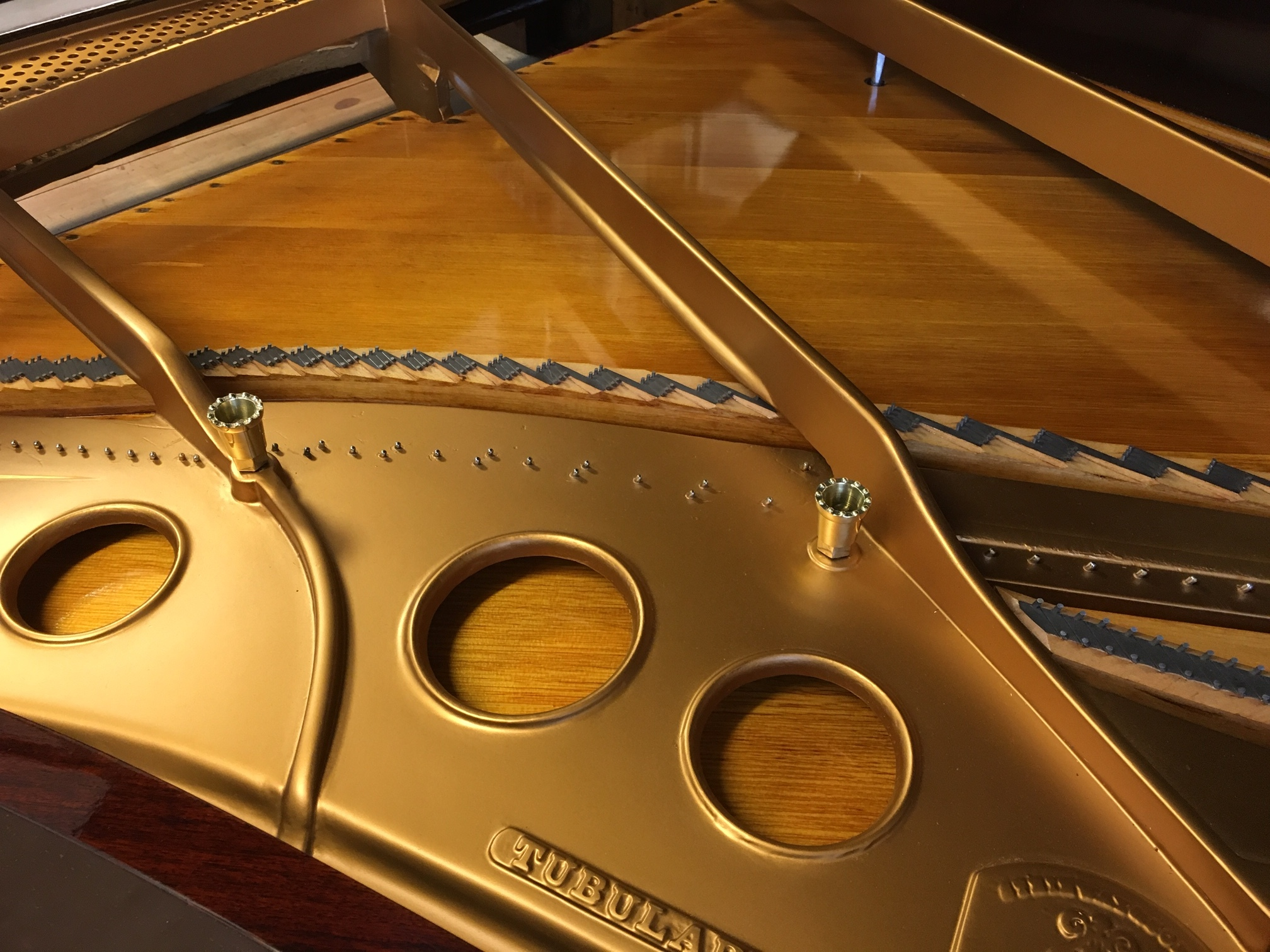 Plate re-gilded, soundboard prepared,   prior to stringing.