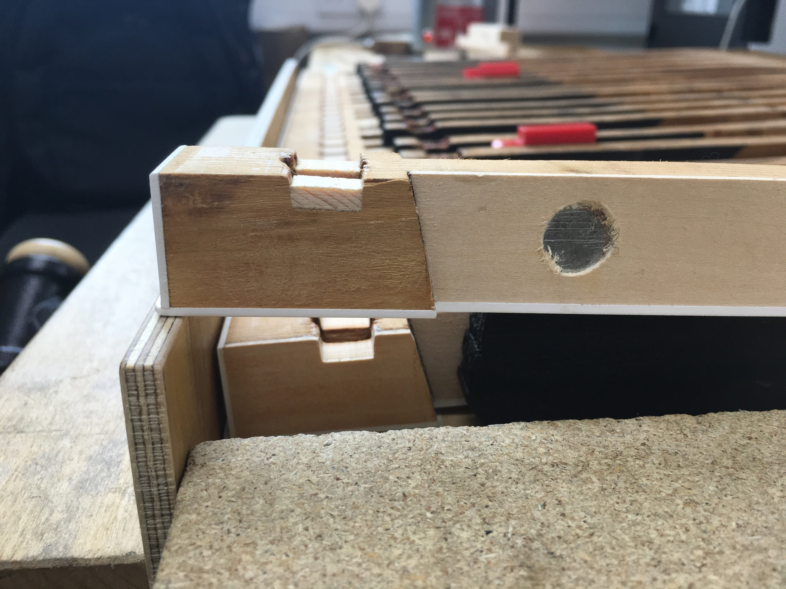 New wood inserted to facilitate correct position of new bushing felts