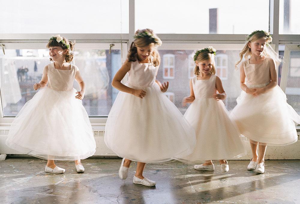 flower girls twirl in their dresses