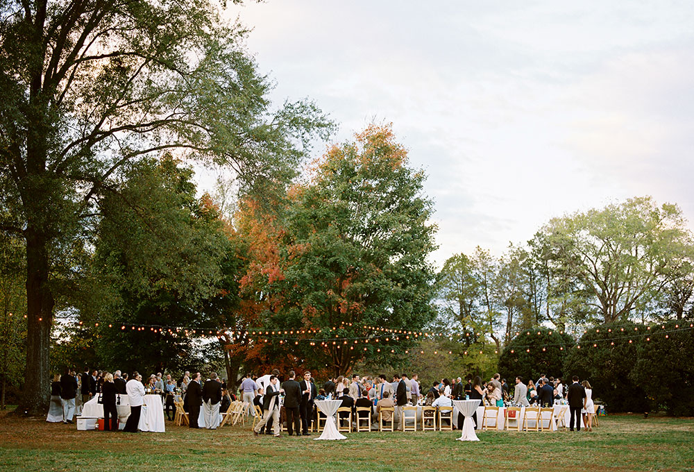 open air reception with string lights