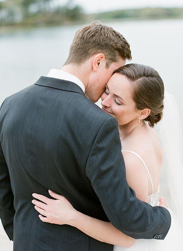 tender moment between bride and groom hugging - Sarah Der Photography