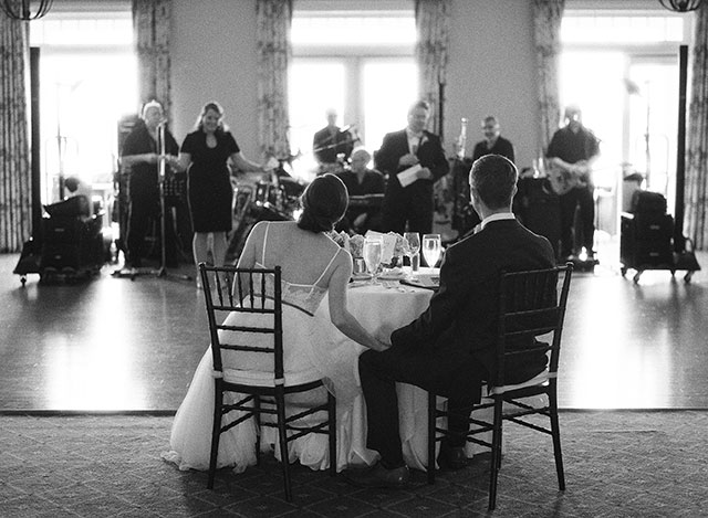 reception indoors at oyster harbor club - Sarah Der Photography