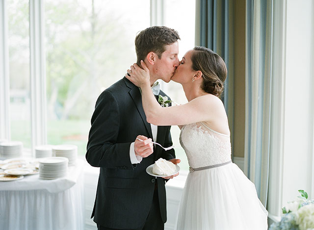 sincere wedding photo of bride and groom kissing - Sarah Der Photography