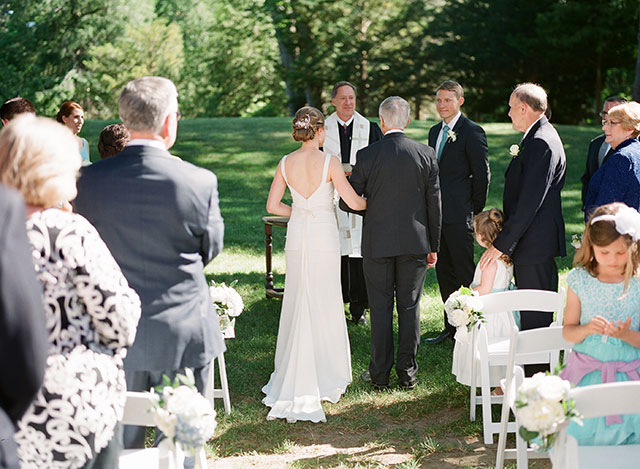 brides father walks her down the aisle