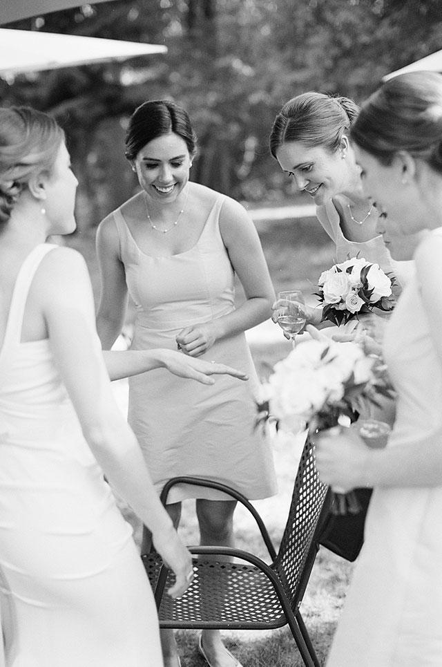 Bridesmaids look at bride's new wedding ring - Sarah Der Photography