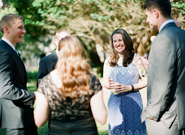 guests laughing during the outdoor cocktail hour - Sarah Der Photography
